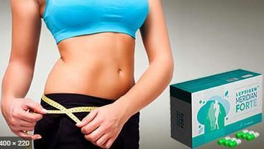 На фото женщина уже явно похудевшая с помощью Leptigen Meridian Forte капсул для похудения измеряет свою талию живота.